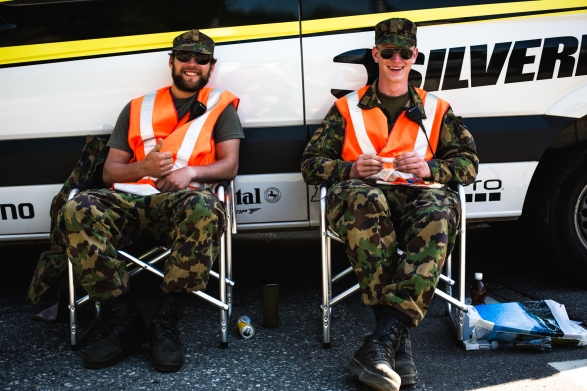 Switzerland has compulsery military service. Being a rather peaceful nation, they tend to have a lot of idle troops. So, they lend them out when a few extra hands are needed, like running security at a race!
