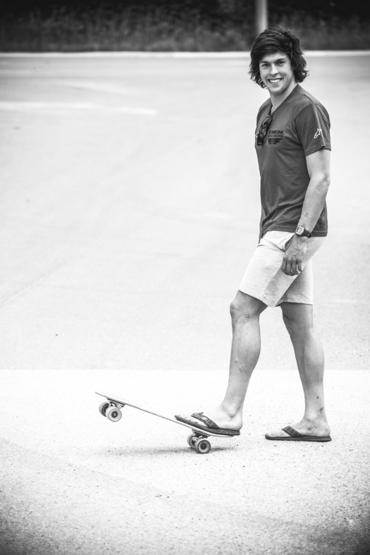 The riders like to relax and goof about during setup days, and Greg decided to rip around on a pennyboard to pass the time.