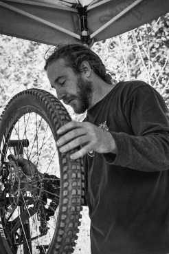 Friend and team mate, talented builder and all around nice guy, Eric does some prep on his race bike after practice on Saturday. || Autumn 2014 | Roxbury, NY ||