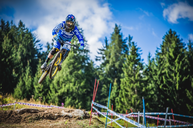 Sam Hill airing out a jump with classic style, cutting inside and keeping it low.