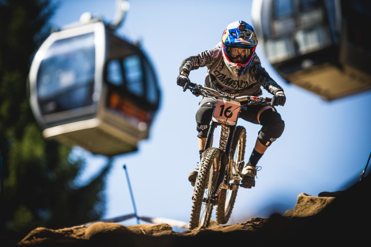 Miriam Nicole dancing through the rocks with gondolas swinging by in the background - it looks like a scene out of Indiana Jones! She's looking comfortable on the rough steeps, and it without a doubt gunning for the top step.