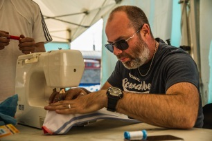 Jack of all trades, Tony Seagrave makes some wardrobe adjustements for his team riders.