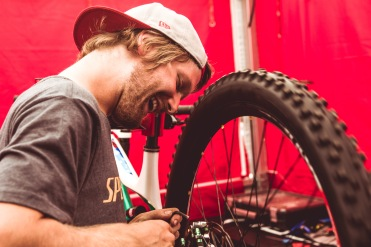 Aaron Pelttarr preps Troy's bike with some laugher and fine care.