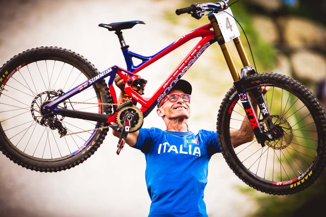 This is what pride looks like. Pipo, the track builder, holding up the winning bike.